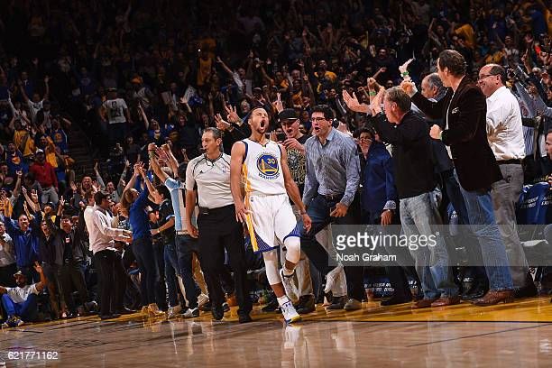 Stephen Curry of the Golden State Warriors celebrates after hitting 13 three pointers breaking the NBA record during the game against the New Orleans...