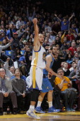 Stephen Curry of the Golden State Warriors celebrates after making a three pointer against the Dallas Mavericks on December 11 2013 at Oracle Arena...