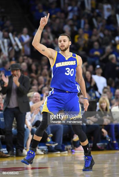 Stephen Curry of the Golden State Warriors celebrates after making a basket against the Memphis Grizzlies during an NBA basketball game at ORACLE...