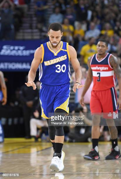 Stephen Curry of the Golden State Warriors celebrates after making a threepoint basket against the Washington Wizards during an NBA Basketball game...