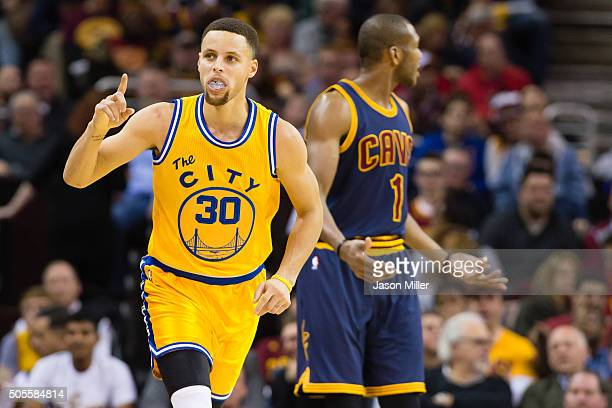 Stephen Curry of the Golden State Warriors celebrates after scoring over James Jones of the Cleveland Cavaliers during the second half at Quicken...