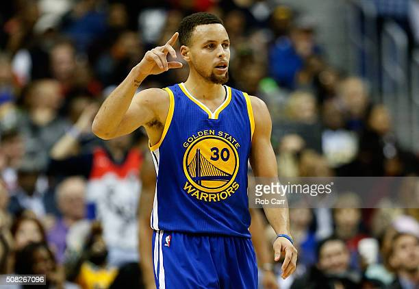 Stephen Curry of the Golden State Warriors celebrates after scoring in the foiurth quarter against the Washington Wizards at Verizon Center on...