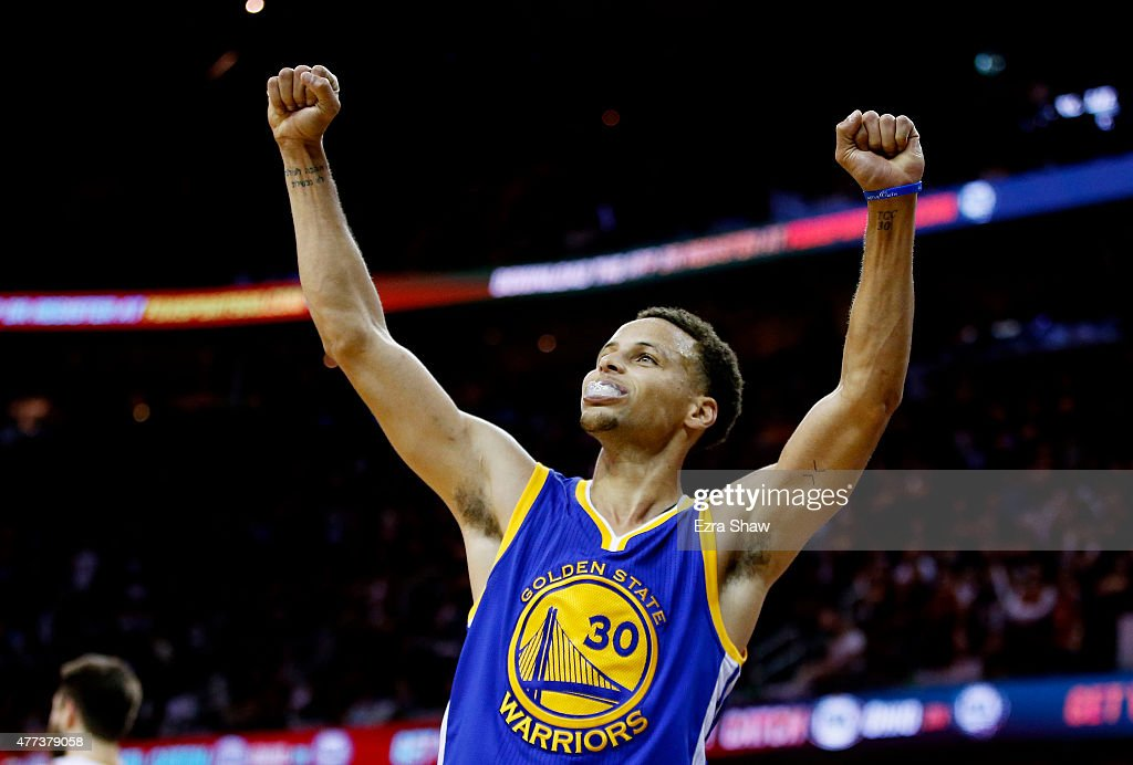Stephen Curry of the Golden State Warriors celebrates after they defeated the Cleveland Cavaliers 105 to 97 in Game Six of the 2015 NBA Finals at...