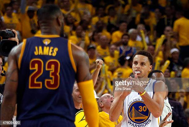Stephen Curry of the Golden State Warriors celebrates as LeBron James of the Cleveland Cavaliers looks on during Game One of the 2015 NBA Finals at...