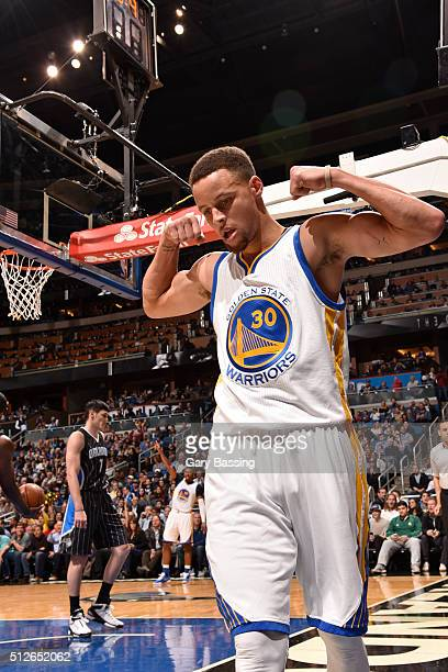 Stephen Curry of the Golden State Warriors celebrates by flexing during the game against the Orlando Magic on February 25 2016 at Amway Center in...