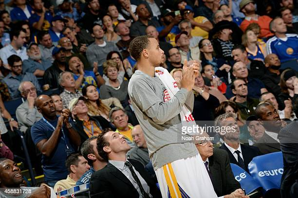 Stephen Curry of the Golden State Warriors celebrates during a game against the San Antonio Spurs on November 11 2014 at Oracle Arena in Oakland...