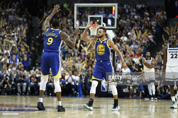 Stephen Curry of the Golden State Warriors celebrates his point with Andre Iguodala of the Golden State Warriors during the game between the...