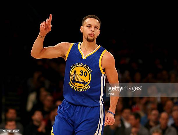 Stephen Curry of the Golden State Warriors celebrates his three point shot in the first half against the New York Knicks at Madison Square Garden on...