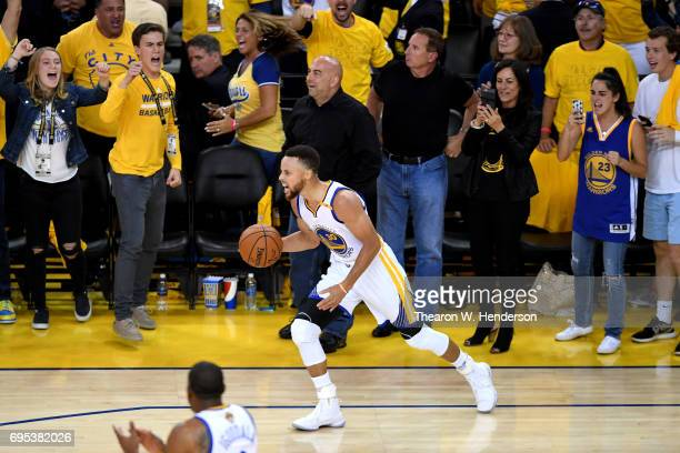 Stephen Curry of the Golden State Warriors celebrates in the final moments of their win over the Cleveland Cavaliers in Game 5 to win the 2017 NBA...