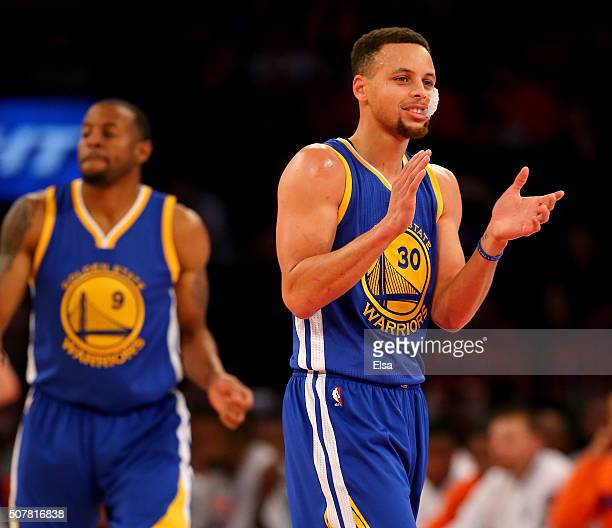 Stephen Curry of the Golden State Warriors celebrates in the first quarter against the New York Knicks at Madison Square Garden on January 31 2016 in...