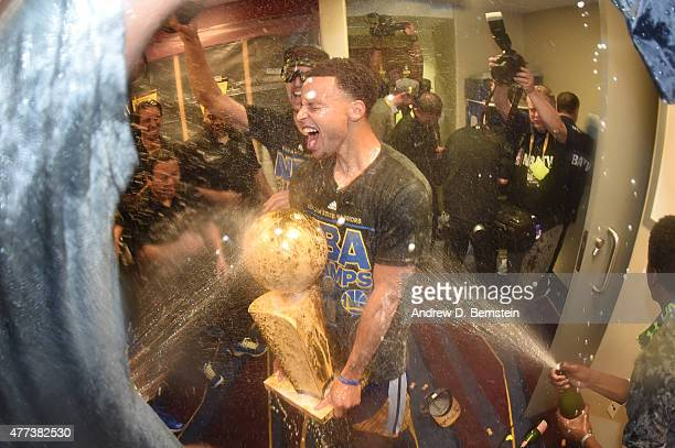 Stephen Curry of the Golden State Warriors celebrates in the locker room after a victory over the Cleveland Cavaliers in Game Six to win the 2015 NBA...