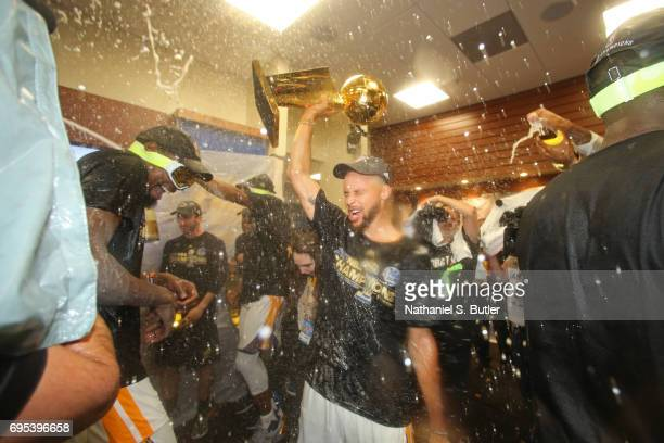 Stephen Curry of the Golden State Warriors celebrates in the locker room after winning the NBA Championsip in Game Five of the 2017 NBA Finals...