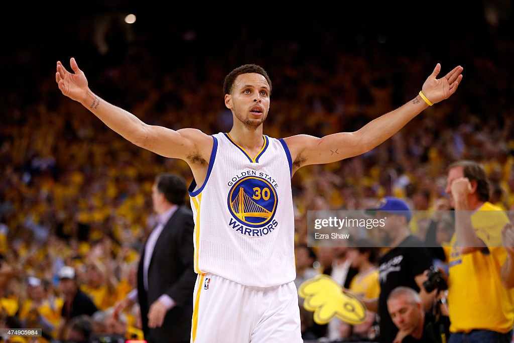 Stephen Curry of the Golden State Warriors celebrates late in the fourth quarter against the Houston Rockets during game five of the Western...