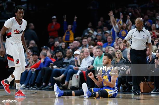 Stephen Curry of the Golden State Warriors celebrates making a three point shot against Al Forouq Aminu of the Portland Trail Blazers during Game...