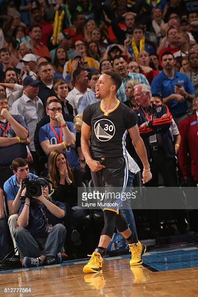 Stephen Curry of the Golden State Warriors celebrates making the game winning shot against the Oklahoma City Thunder on February 27 2016 at the...