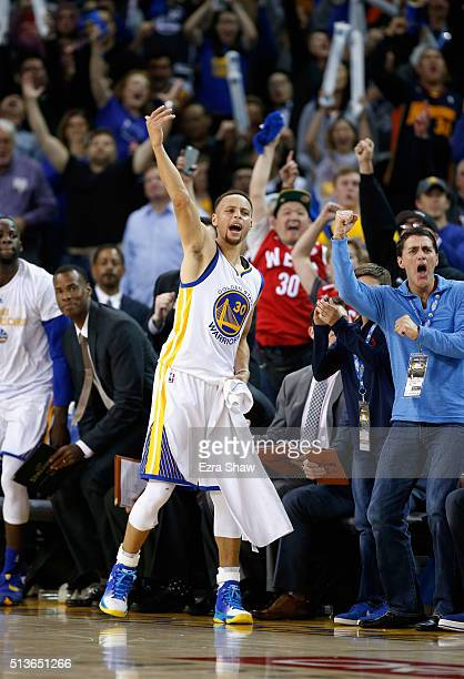Stephen Curry of the Golden State Warriors celebrates on the bench during their game against the Oklahoma City Thunder at ORACLE Arena on March 3...