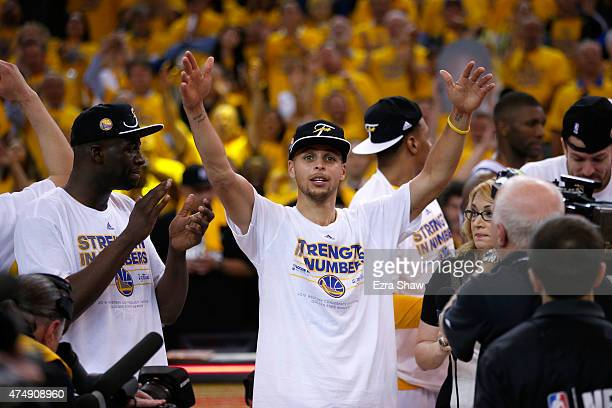 Stephen Curry of the Golden State Warriors celebrates the Warriors 10490 victory against the Houston Rockets during game five of the Western...