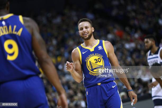 Stephen Curry of the Golden State Warriors celebrates with Andre Iguodala of the Golden State Warriors during the game between the Minnesota...