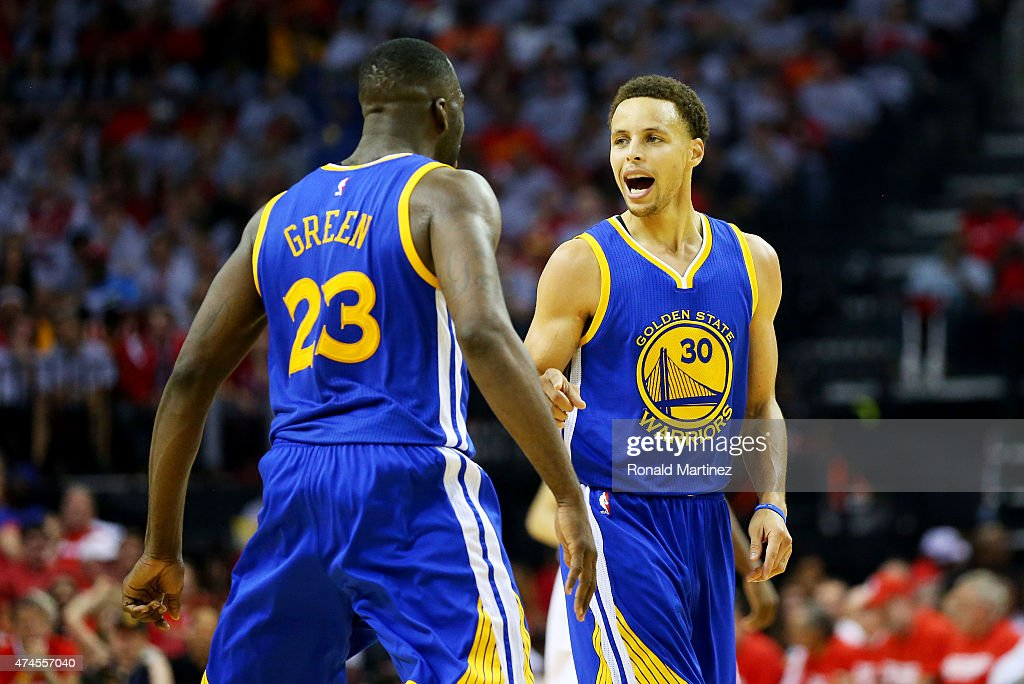 Stephen Curry #30 of the Golden State Warriors celebrates with Draymond Green #23 after setting the record for most three pointers in a post season in the second quarter against the Houston Rockets during Game Three of the Western Conference Finals of the 2015 NBA PLayoffs at Toyota Center on May 23, 2015 in Houston, Texas.