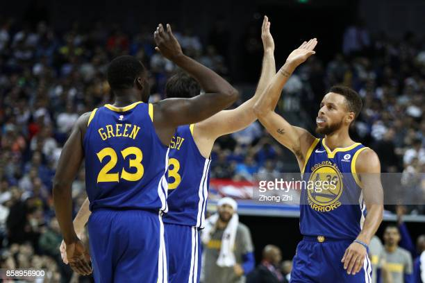 Stephen Curry of the Golden State Warriors celebrates with Draymond Green of the Golden State Warriors during the game between the Minnesota...