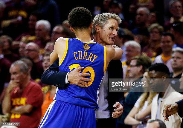 Stephen Curry of the Golden State Warriors celebrates with head coach Steve Kerr after they defeated the Cleveland Cavaliers 105 to 97 in Game Six of...
