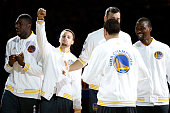 Stephen Curry of the Golden State Warriors celebrates with his teammates after receiving his championship ring prior to their game against the New...