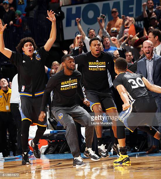 Stephen Curry of the Golden State Warriors celebrates with his teammates after hitting the game winning shot against the Oklahoma City Thunder on...