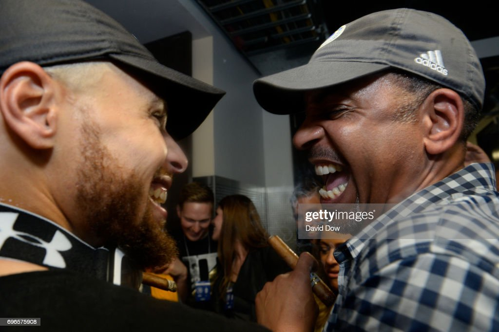 Stephen Curry #30 of the Golden State Warriors celebrates with his father Dell Curry in the hallway after winning Game Five of the 2017 NBA Finals against the Cleveland Cavaliers on June 12, 2017 at ORACLE Arena in Oakland, California.