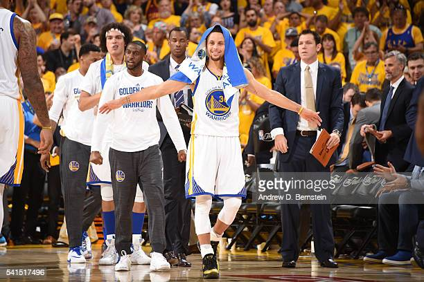 Stephen Curry of the Golden State Warriors celebrates with his teammates on the bench during the game against the Cleveland Cavaliers in Game Seven...