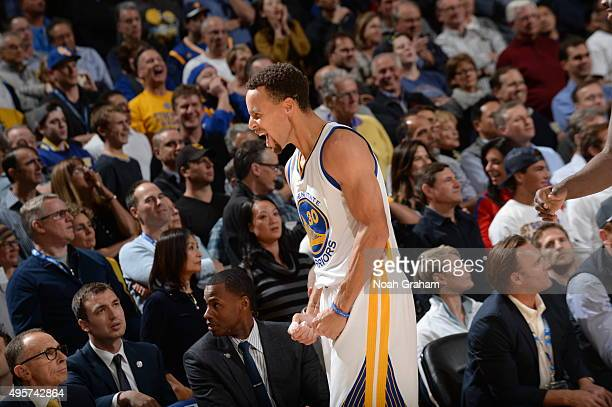 Stephen Curry of the Golden State Warriors celebrates with his teammates during the game against the Los Angeles Clippers on November 4 2015 at...