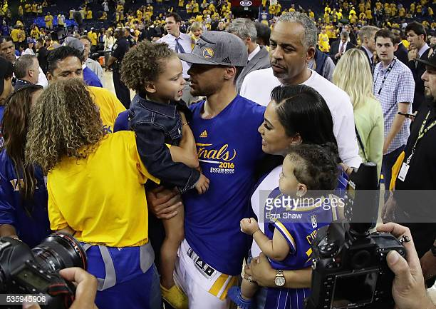 Stephen Curry of the Golden State Warriors celebrates with his wife Ayesha Curry and girls Riley and Ryan and father Dell Curry after they beat the...