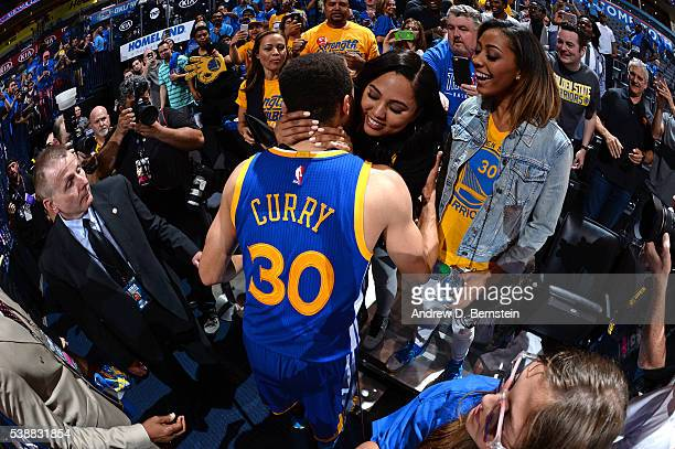 Stephen Curry of the Golden State Warriors celebrates with his wife Ayesha as he leaves the court after Game Six of the Western Conference Finals...