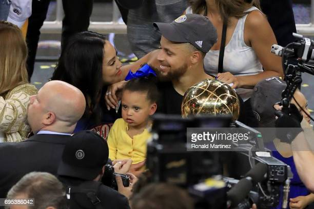 Stephen Curry of the Golden State Warriors celebrates with his wife Ayesha after defeating the Cleveland Cavaliers 129120 in Game 5 to win the 2017...