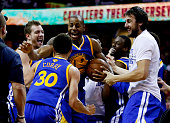 Stephen Curry of the Golden State Warriors celebrates with teammates after they defeated the Cleveland Cavaliers 105 to 97 in Game Six of the 2015...