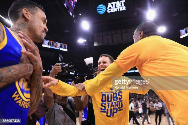 Stephen Curry of the Golden State Warriors celebrates with teammates after defeating the San Antonio Spurs 129115 in Game Four of the 2017 NBA...
