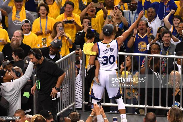 Stephen Curry of the Golden State Warriors celebrates with the fans after defeating the Cleveland Cavaliers in Game Five of the 2017 NBA Finals on...