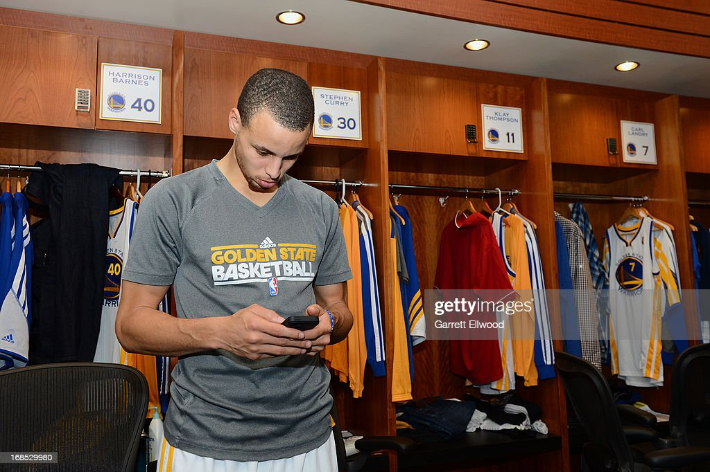 Stephen Curry #30 of the Golden State Warriors checks his Iphone in the locker room prior to the game against the San Antonio Spurs in Game Three of the Western Conference Semifinals during the 2013 NBA Playoffs on May 10, 2013 at the Oracle Arena in Oakland, California.