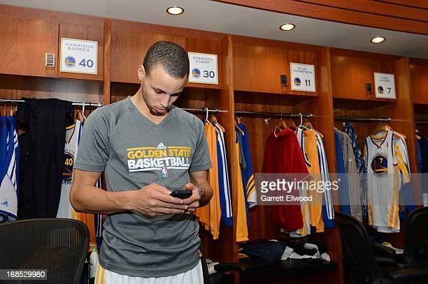 Stephen Curry of the Golden State Warriors checks his Iphone in the locker room prior to the game against the San Antonio Spurs in Game Three of the...