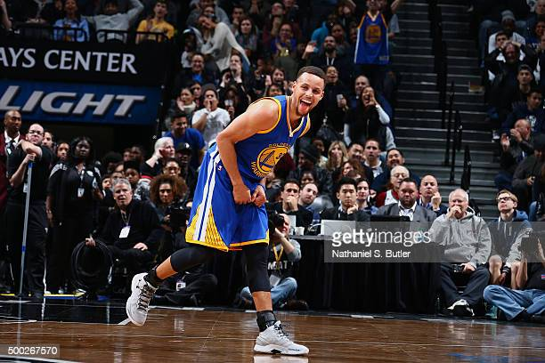 Stephen Curry of the Golden State Warriors cheers during the game against the Brooklyn Nets on December 6 2015 at Barclays Center in Brooklyn New...
