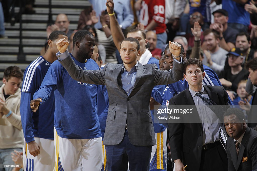 Stephen Curry #30 of the Golden State Warriors cheers from the bench during a game against the Dallas Mavericks on January 31, 2013 at Oracle Arena in Oakland, California.