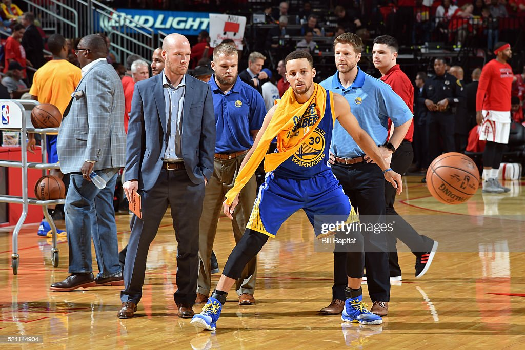Stephen Curry of the Golden State Warriors comes out of the locker room after halftime and warms up during Game Four of the Western Conference...