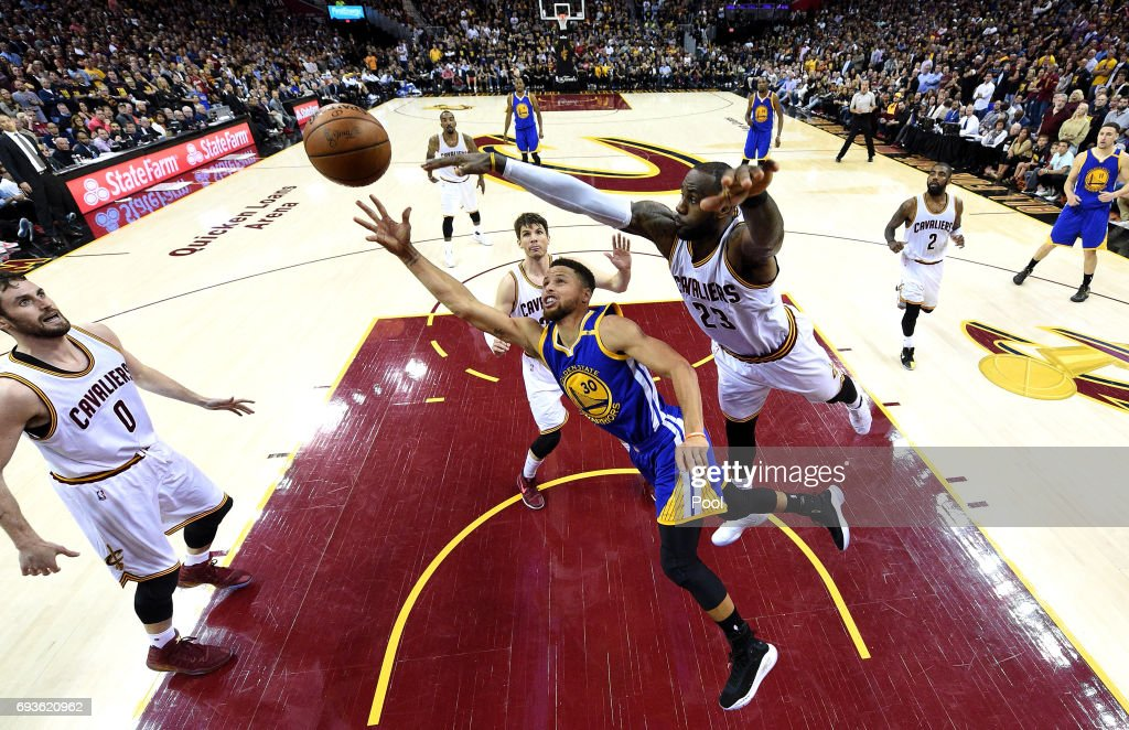 Stephen Curry #30 of the Golden State Warriors competes for the ball with LeBron James #23 of the Cleveland Cavaliers in the second half in Game 3 of the 2017 NBA Finals at Quicken Loans Arena on June 7, 2017 in Cleveland, Ohio.
