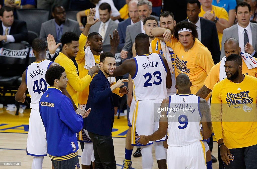 Stephen Curry #30 of the Golden State Warriors congratulates Andre Iguodala #9 during a time out of their game against the Portland Trail Blazers during Game One of the Western Conference Semifinals for the 2016 NBA Playoffs at ORACLE Arena on May 01, 2016 in Oakland, California.
