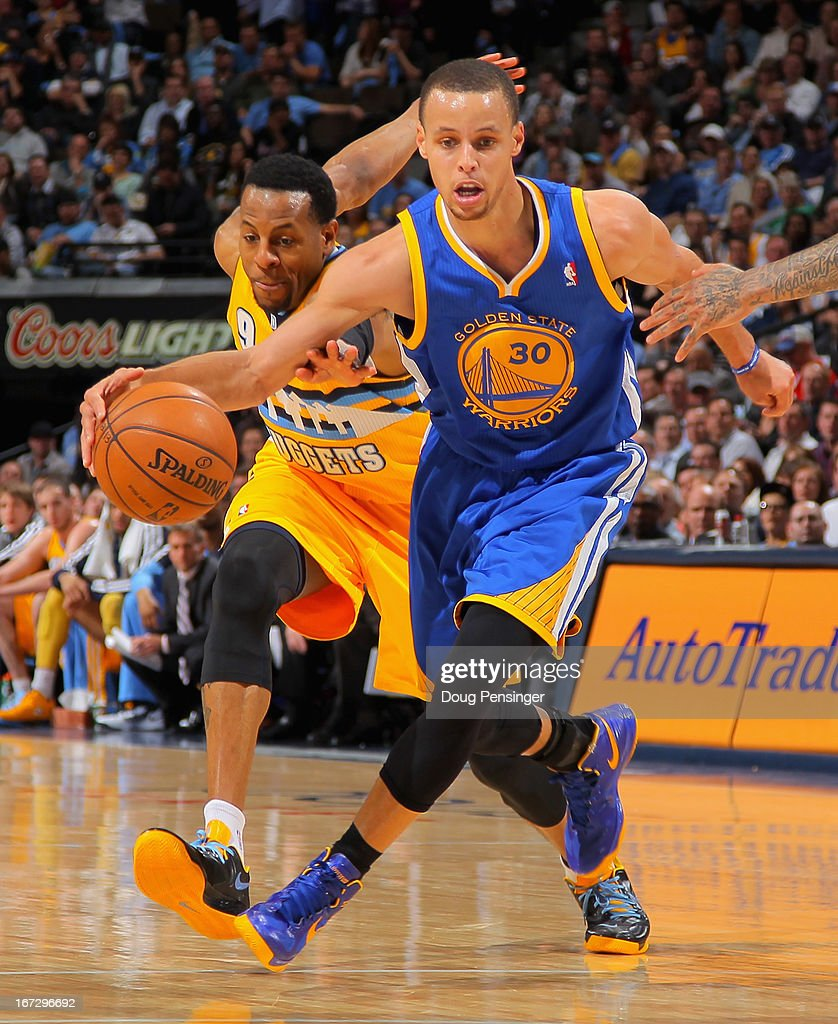 Stephen Curry #30 of the Golden State Warriors controls the ball against Andre Iguodala #9 of the Denver Nuggets during Game Two of the Western Conference Quarterfinals of the 2013 NBA Playoffs at the Pepsi Center on April 23, 2013 in Denver, Colorado.