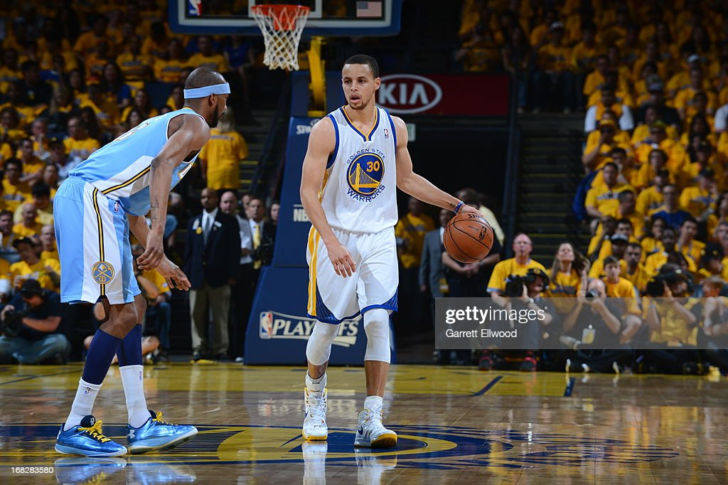 Stephen Curry #30 of the Golden State Warriors controls the ball against <a gi-track='captionPersonalityLinkClicked' href=/galleries/search?phrase=Corey+Brewer&family=editorial&specificpeople=234749 ng-click='$event.stopPropagation()'>Corey Brewer</a> #13 of the Denver Nuggets in Game Four of the Western Conference Quarterfinals during the 2013 NBA Playoffs on April 28, 2013 at the Oracle Arena in Oakland, California.