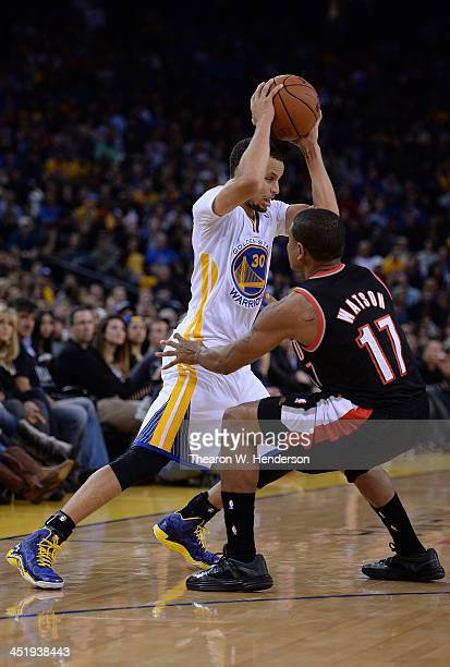 Stephen Curry of the Golden State Warriors controls the ball guarded by Earl Watson of the Portland Trail Blazers at ORACLE Arena on November 23 2013...