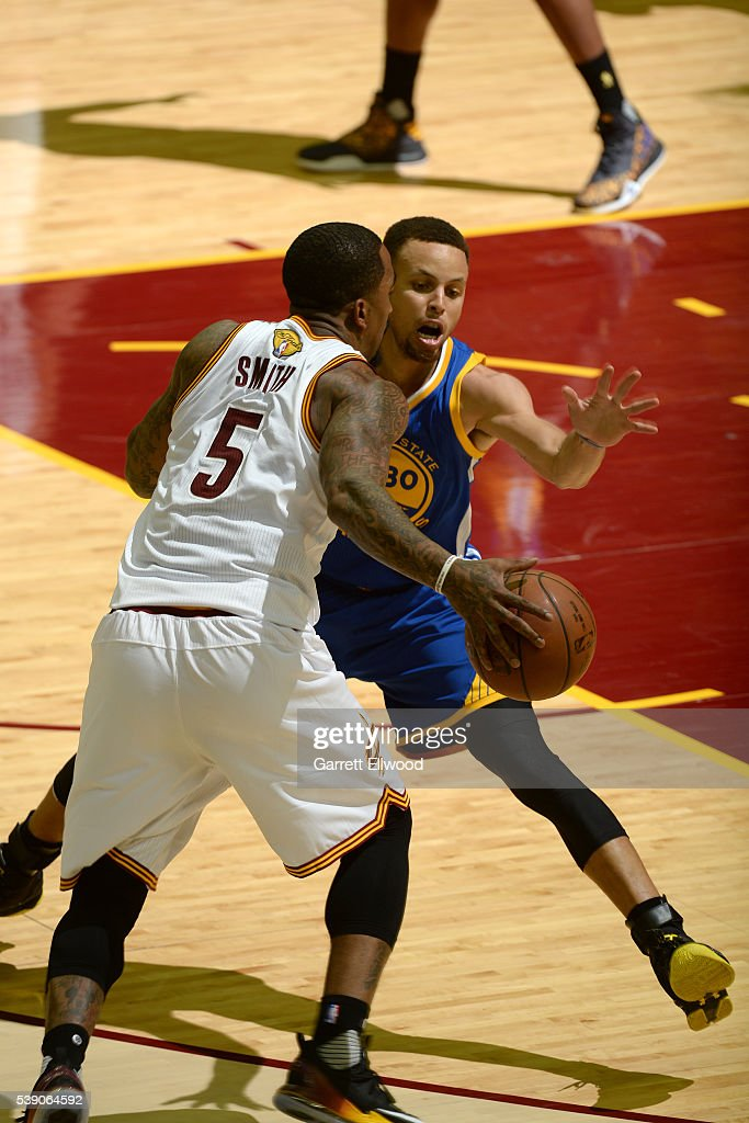 Stephen Curry #30 of the Golden State Warriors defends against J.R. Smith #5 of the Cleveland Cavaliers during the 2016 NBA Finals Game Three on June 8, 2016 at Quicken Loans Arena in Cleveland, Ohio.