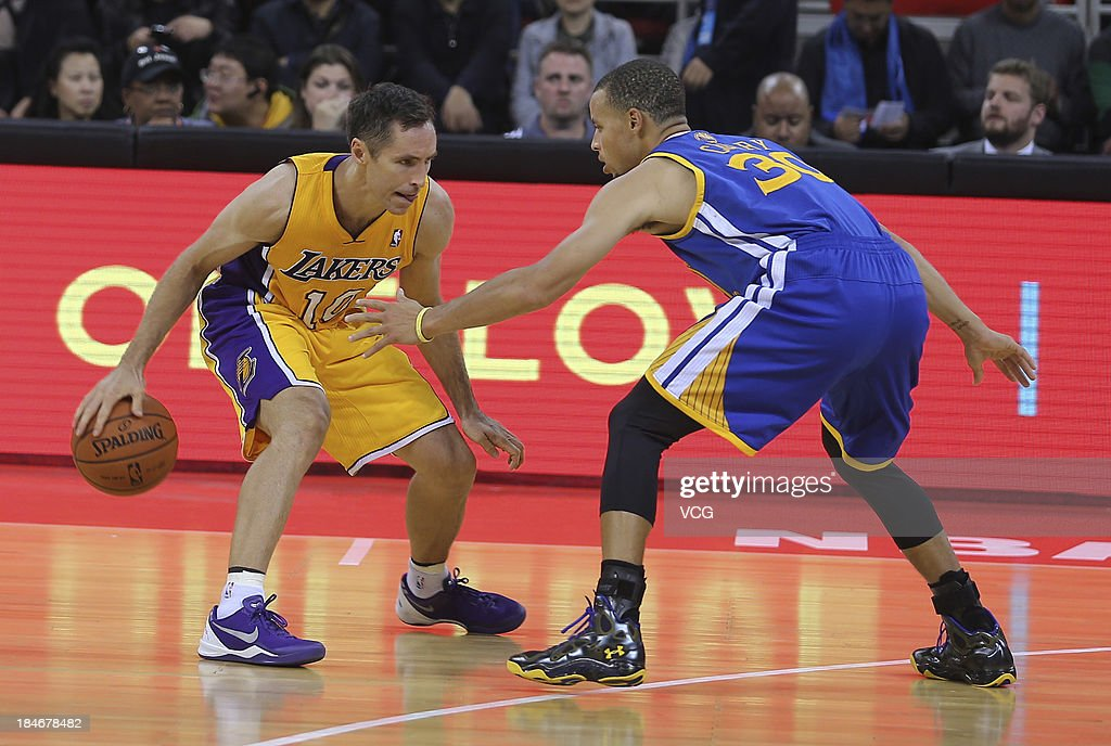 Stephen Curry #30 of the Golden State Warriors defends against <a gi-track='captionPersonalityLinkClicked' href=/galleries/search?phrase=Steve+Nash+-+Basketball+Player&family=editorial&specificpeople=201513 ng-click='$event.stopPropagation()'>Steve Nash</a> #10 of the Los Angeles Lakers during the 2013 Global Games at the MasterCard Center on October 15, 2013 in Beijing, China.
