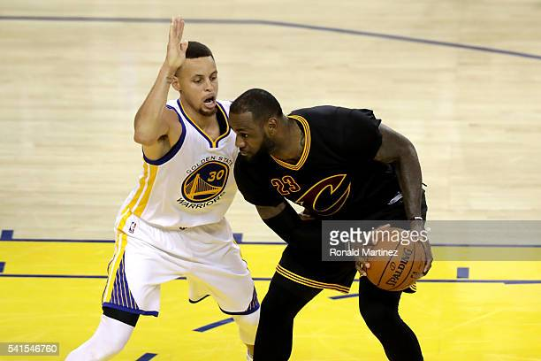Stephen Curry of the Golden State Warriors defends LeBron James of the Cleveland Cavaliers in Game 7 of the 2016 NBA Finals at ORACLE Arena on June...