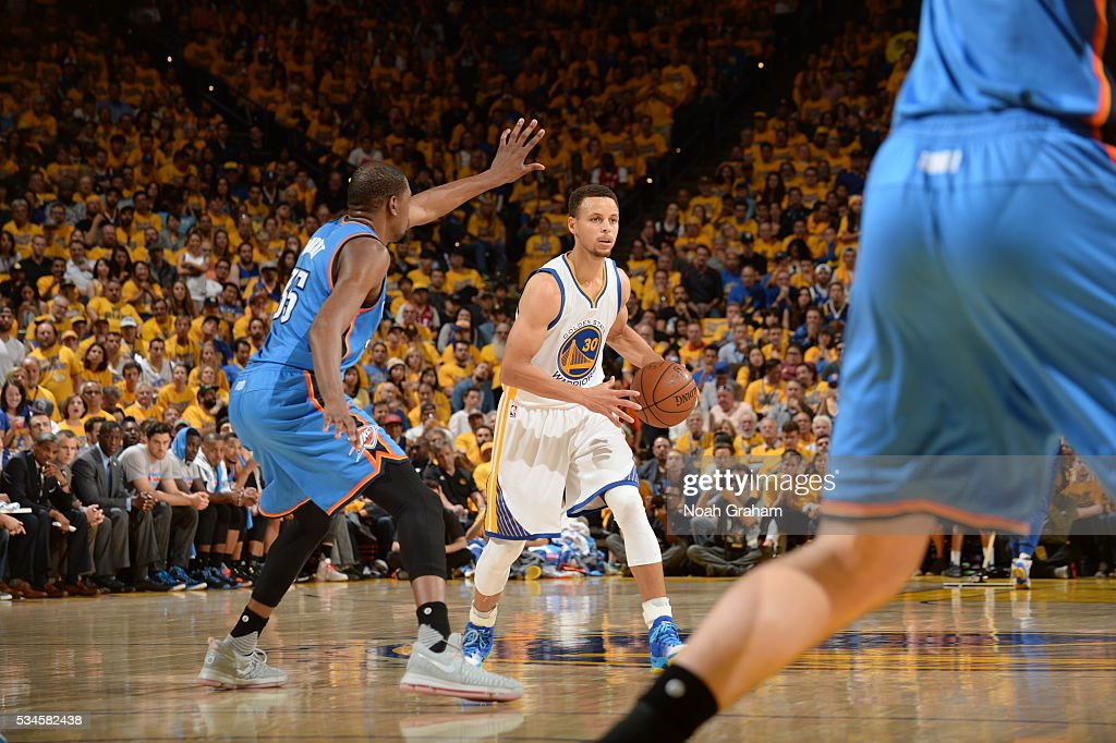 <a gi-track='captionPersonalityLinkClicked' href=/galleries/search?phrase=Stephen+Curry+-+Basketball+Player&family=editorial&specificpeople=5040623 ng-click='$event.stopPropagation()'>Stephen Curry</a> #30 of the Golden State Warriors defends the ball against the Oklahoma City Thunder during Game Five of the Western Conference Finals during the 2016 NBA Playoffs on May 26, 2016 at ORACLE Arena in Oakland, California.